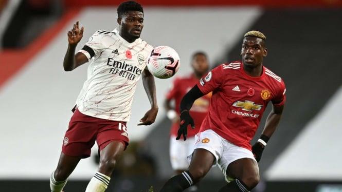 Duel gelandang Arsenal, Thomas Partey dan gelandang MU, Paul Pogba