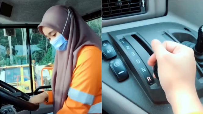 Perempuan mengemudikan dump truck