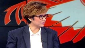 Yuni Kartika saat menjadi komentator bulutangkis.