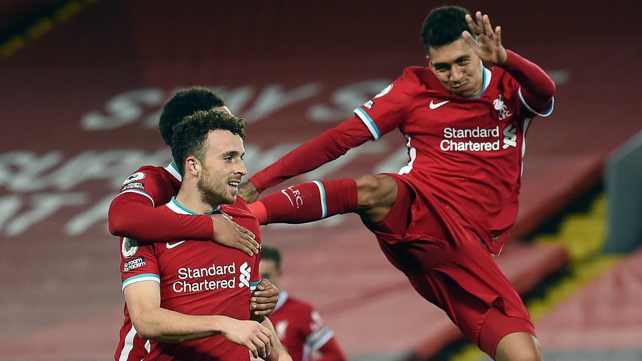 Selebrasi gol Liverpool. Diogo Jota dan tendangan maut Roberto Firmino