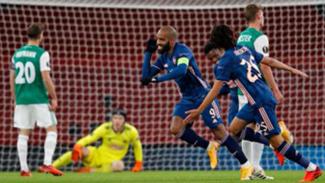 Selebrasi bomber Arsenal, Alexandre Lacazette usai bobol gawang Rapid Wien.