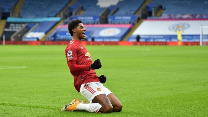 Penyerang Manchester United, Marcus Rashford usai cetak gol.
