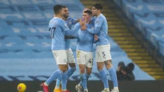 Gelandang Manchester City, Phil Foden, merayakan gol ke gawang Brighton