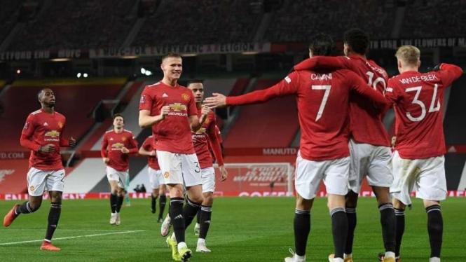 Selebrasi pemain MU usai bikin gol ke gawang Liverpool