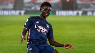 Bek Arsenal, Bukayo Saka rayakan gol.