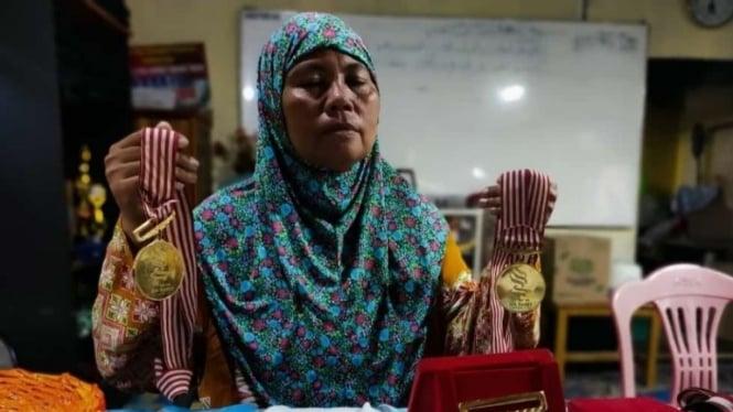 Mantan atlet dayung Indonesia, Leni Haini
