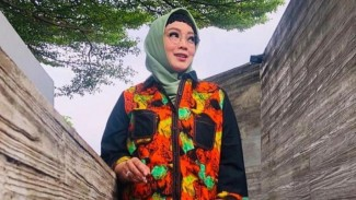 Rina Gunawan.