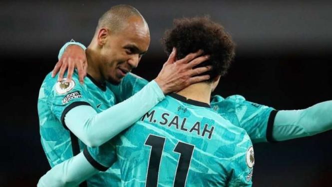 Mohamed Salah merayakan gol
