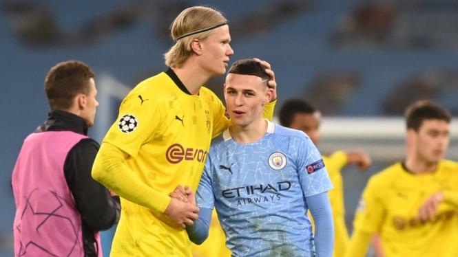 Phil Foden dan Erling Haaland usai laga Manchester City vs Borussia Dortmund