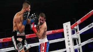 Pertarungan antara Sadam Ali dan Jaime Munguia