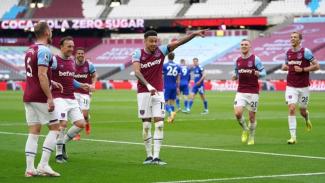 jesse Lingard merayakan gol ke gawang Leicester City