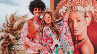 Indah Kalalo dan suami.