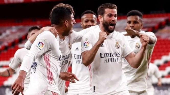 Real Madrid merayakan gol