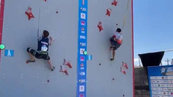 Kiromal Katibin saat memecahkan rekor dunia panjat tebing