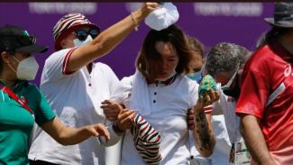 Atlet panahan Rusia, Svetlana Gomboeva, yang baru sadarkan diri usai pingsan.