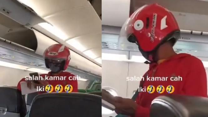Viral Penumpang Pesawat Pakai Helm (Instagram/energisolo)