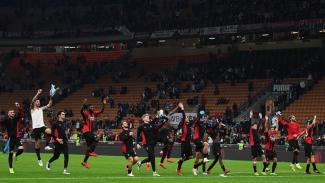 Pemain AC Milan merayakan kemenangan