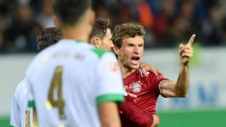 Pemain Bayern Munich, Thomas Mueller rayakan gol.