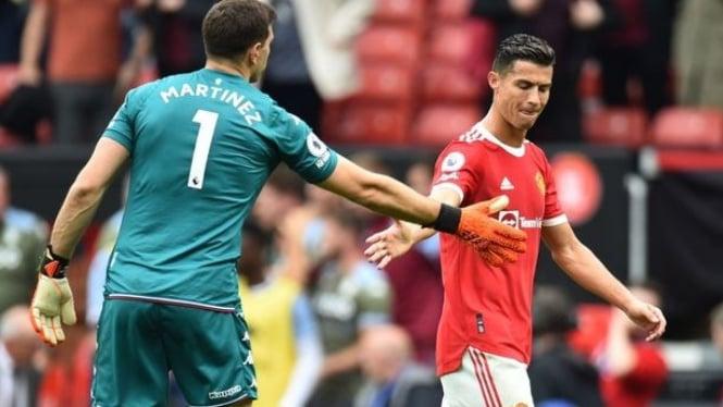 Emiliano Martinez dan Cristiano Ronaldo