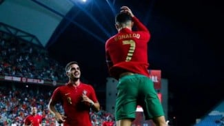 Kapten Timnas Portugal, Cristiano Ronaldo rayakan gol.
