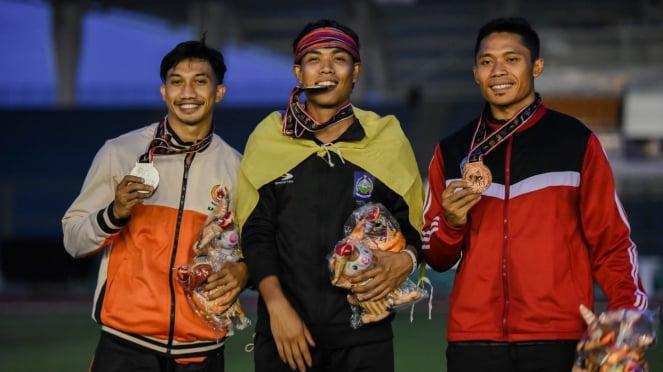 Spinter NTB, Lalu Muhammad Zohri (tengah) di PON XX Papua